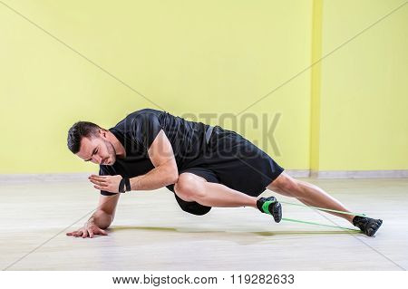 Guy working out in studio gym.