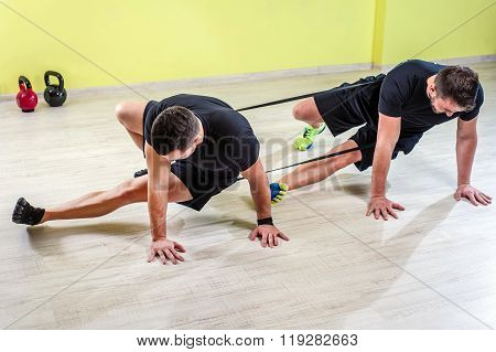 Two guy's working out in studio gym.