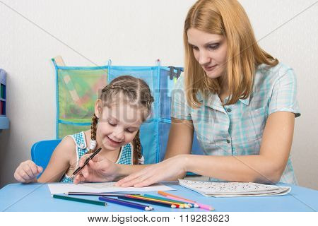 Girl Happily Looks At Painted With The Help Of Drawing The Line