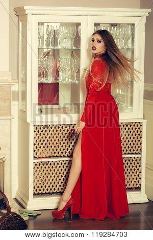 Woman Near Glass Shelf