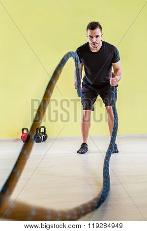 Fitness battling ropes at gym workout fitness exercise