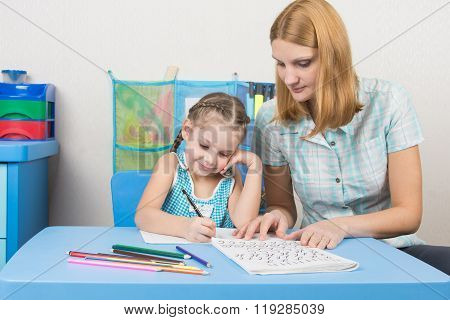 Young Mother Prepares A Five-year Girl To School