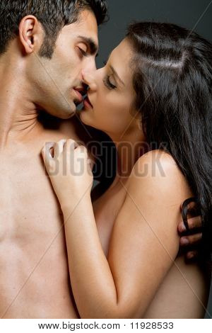 Young ethnic couple kissing each other