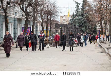 People Walk Along Street Of The Ukrainian City.