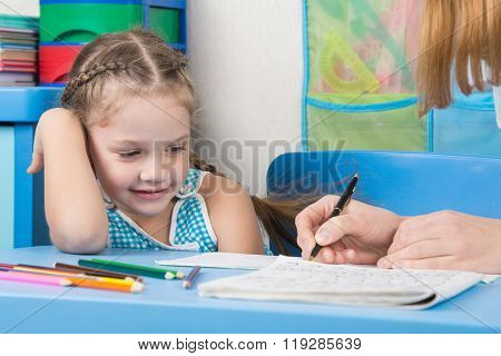 Five-year Girl With A Smile Looking At My Mother Explaining How To Write Letters