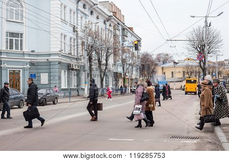 People Cross The Road At Pedestrian Crossing.