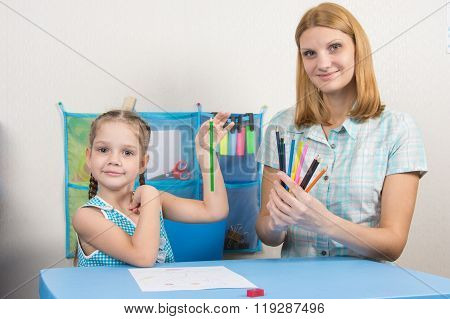 The Five-year Child Chose The Correct Pencil From Mother Hands And Looked Into The Frame