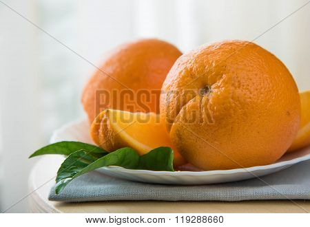 Orange Fruit And Green Leaves Isolated On White Background