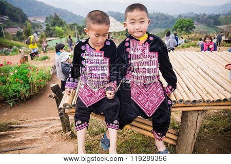 MON CHAM CHIANGMAI/THAILAND - JAN 19: Unidentified smiling Hmong hill tribe in Hmong Village on January 19 2014.CHIANGMAI THAILAND.