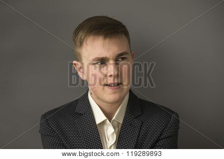 Aggressive young manager in a business suit