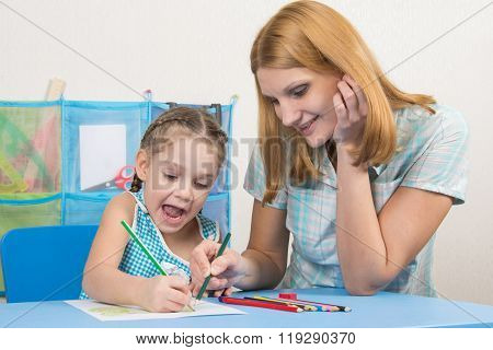 Five-year Girl And Young Mother Having Fun Drawing Happy Drawing With Crayons