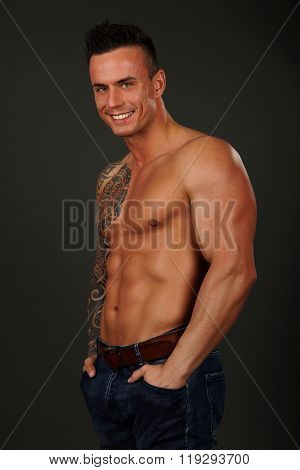 Muscular man poses