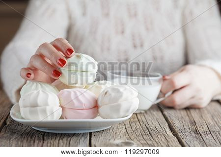 Woman Drinking Milk And Eating Sweets
