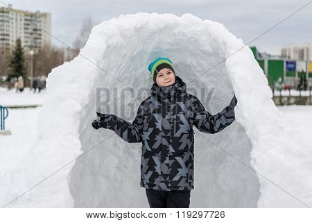 Teen Boy Standing In  Makeshift Snow Fort