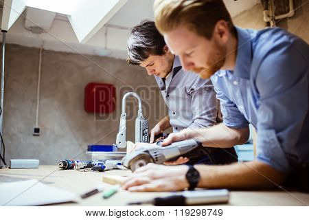 Two Designers Working On A Project