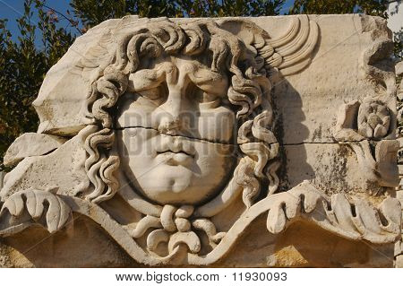 Close-up of an ancient sculpture of Medusa.
