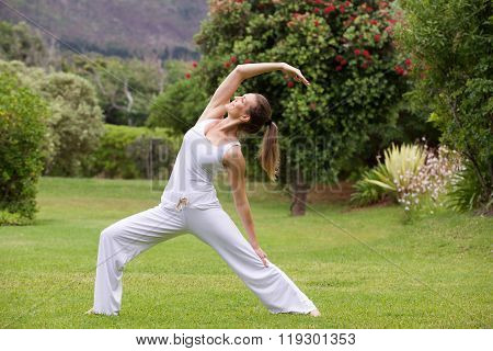 Yoga Woman Practising Outside In Park