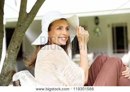 Attractive Woman Smiling With Sun Hat