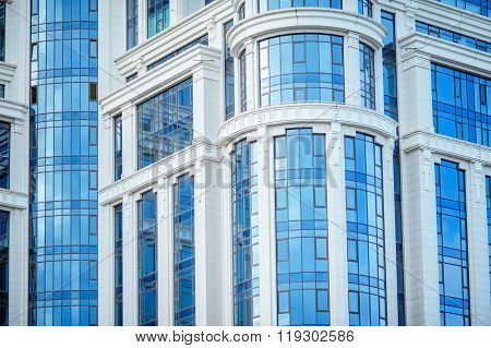 fragment of modern blue office building with windows