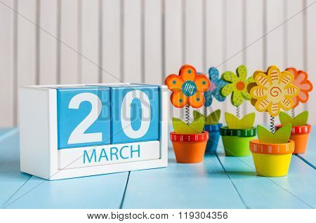 March 20th. Image of march 20 wooden color calendar with flower on white background.  Spring day