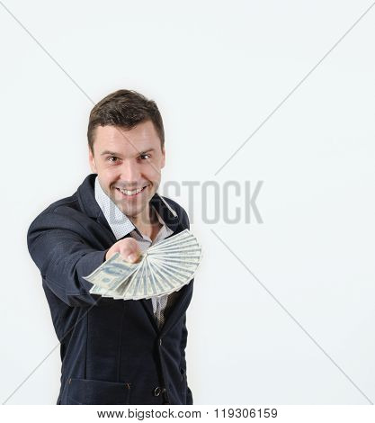 Businessman Offering A Wad Of Money In Studio On A White Background