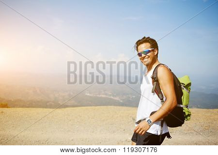 Cheerful male enjoying beautiful nature view
