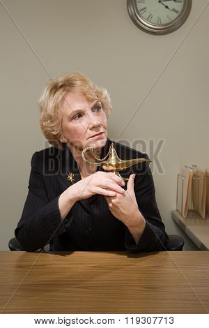 Woman holding a genie lamp