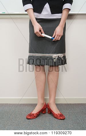 Woman wearing red shoes