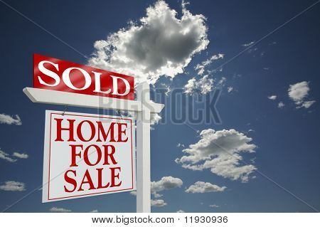Sold Home for Sale sign, dramatic clouds background, room for your message. See my theme variations.