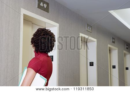 Woman waiting for elevator
