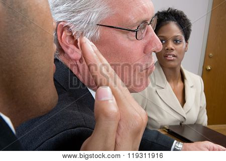 Man whispering in interview