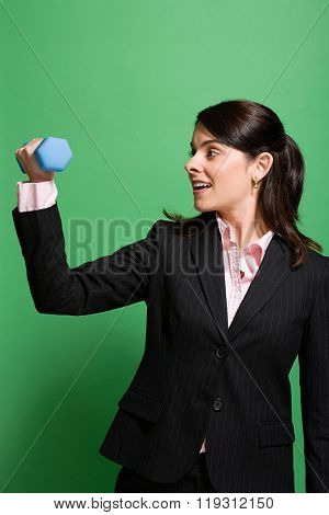 Businesswoman weightlifting