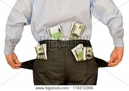 men businessman showing empty pockets hiding behind wads of money