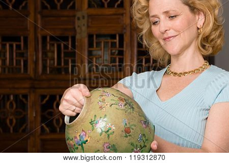 Woman looking at a vase