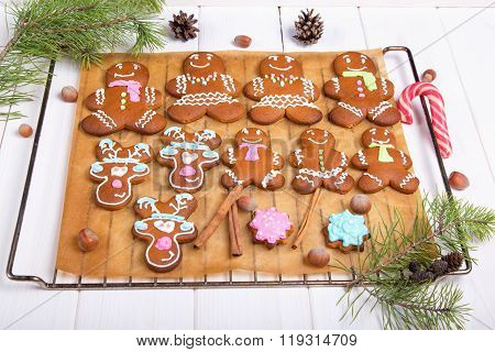 Gingerbread men on parchment paper. Some freshly baked home made gingerbread men arranged on some creased parchment paper (baking paper). Gingerbread Cookies.