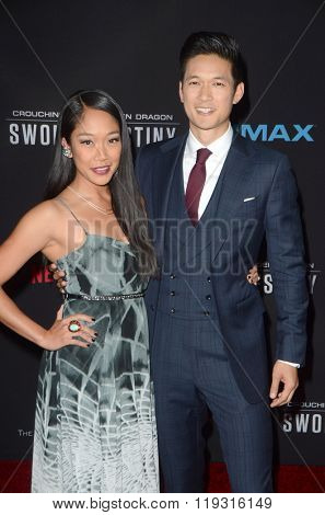 LOS ANGELES - FEB 22:  Shelby Rabara, Harry Shum Jr. at the Crouching Tiger  Hidden Dragon - Sword of Destiny Premiere at the AMC Universal Citywalk on February 22, 2016 in Universal City, CA