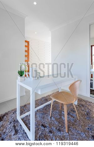 White Wooden Table And Light Wooden Chair In The Modern Room