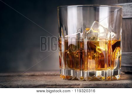 Glare glass of whiskey with ice
