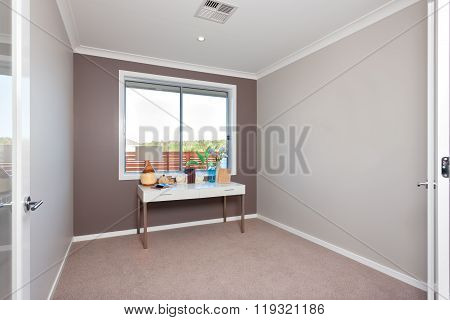 Table With Decorative Items Isolated Near The Window In A Modern Room With Carpet On The Floor
