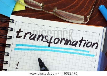 Transformation concept  written in a notebook.