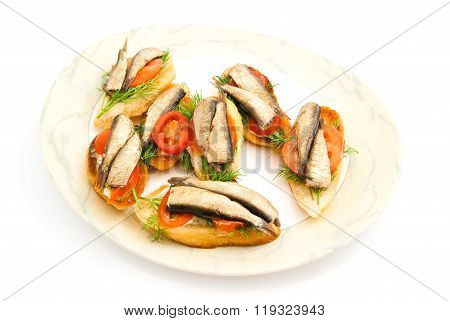 Sandwiches With Sprats On Glass Plate