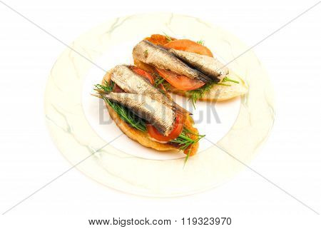 Pair Of Sandwiches With Sprats On Plate