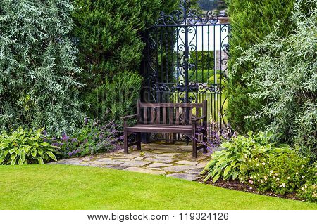Brown Wooden Garden Bench In The Old Victorian Garden