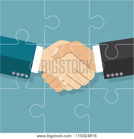 Handshake Businessman Agreement.  Partnership Puzzle. Partnership Concept.