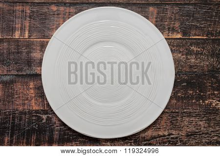 Round Empty Plate On Wooden Table