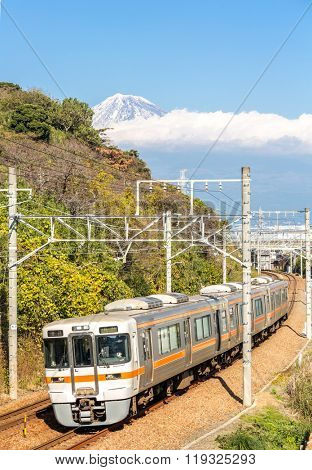 SHIZUOKA JAPAN - DEC 1: JR Tokaido main line train with Mt. Fuji landscape in Shizuoka ,Japan on DEC 1 ,2015. The Tokaido main line is a major Japanese railway line connecting Tokyo and Kobe stations.