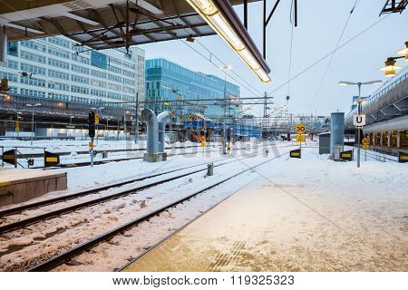 STOCKHOLM, SWEDEN - DEC 22: Stockholm central train station platform in winter Stockholm Sweden on december 22. 2012. This is the largest railway station in Sweden service over 200,000 visitors daily.