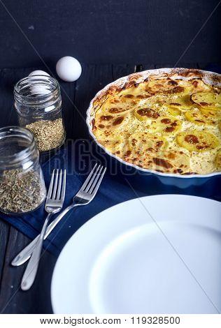 Potato gratin with cream, eggs and cheese