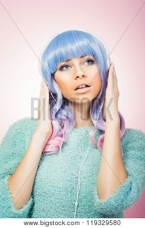Fashionable Young Woman With Pastel Hair Listening To Music On Headphones