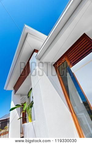 Low Angle View Of A Modern Mansion With Blue Sky Background